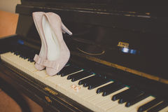 Beautiful beige shoes from bride on the piano Stock Images