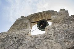 Beautiful bell in old arch. In ruins of a historical building Stock Image