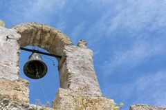 Beautiful bell in old arch. In ruins of a historical building Stock Photos