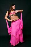 Beautiful belly dancer in action Stock Images