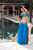 Beautiful Belly Dancer in a Blue Costume Royalty Free Stock Images