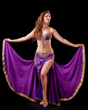 Beautiful belly dancer  holding out skirt Stock Images