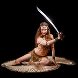 Beautiful belly dancer holding sword out Royalty Free Stock Photography