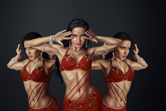 Beautiful belly dancer Stock Photos