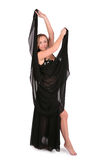 Beautiful belly dancer posing with a veil Stock Images