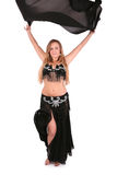 Beautiful belly dancer posing with a veil Royalty Free Stock Image