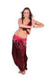 Beautiful belly dancer in red costume Royalty Free Stock Image