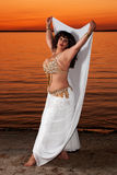 Beautiful belly dancer on the sand Royalty Free Stock Image