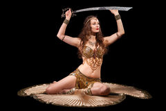 Beautiful belly dancer with sword Royalty Free Stock Photography