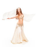 Beautiful belly dancer  turning with veil Royalty Free Stock Photography