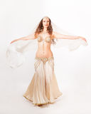 Beautiful belly dancer  turning with veil Stock Images