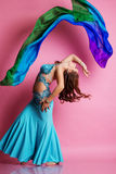 Beautiful belly dancer is wearing a blue costume Royalty Free Stock Photography