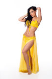 Beautiful Belly Dancer Wearing a Bright Yellow Costume Royalty Free Stock Photography