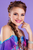 Beautiful belly dancer wearing a purple costume Stock Photography