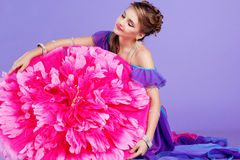 Beautiful belly dancer wearing a purple costume Stock Images