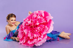 Beautiful belly dancer wearing a purple costume Stock Image