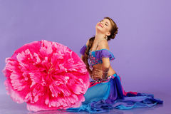 Beautiful belly dancer wearing a purple costume Royalty Free Stock Photos