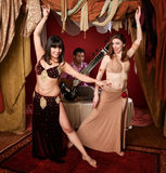 Beautiful Belly Dancers With Sitar Musician Stock Images