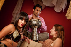 Beautiful Belly Dancers with Tabla Player Royalty Free Stock Photo