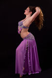 Beautiful bellydancer holding her hair Stock Image