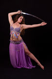 Beautiful bellydancer holding a sword Royalty Free Stock Photos