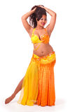 Beautiful bellydancer in yellow and orange Stock Images