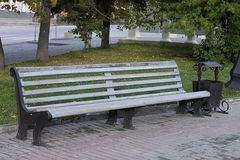 A beautiful bench in autumn park royalty free stock photos