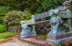 Beautiful bench with sculptures. Of mythical creatures Stock Image