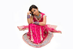 Beautiful Bengali bride. In colorful dress day dreaming, isolated royalty free stock photos