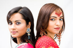 Beautiful Bengali brides. Two beautiful Bengali brides in colorful dresses, isolated royalty free stock images