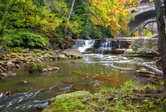 Beautiful Berea Falls In Autumn. Berea Falls Ohio with fall colors. This cascading waterfall looks it`s best with autumn colors in the trees. The stone arch stock photography