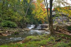 Beautiful Berea Falls In Autumn. Berea Falls Ohio with fall colors. This cascading waterfall looks it`s best with autumn colors in the trees. The stone arch stock photos
