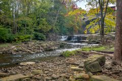 Beautiful Berea Falls In Autumn. Berea Falls Ohio with fall colors. This cascading waterfall looks it`s best with autumn colors in the trees. The stone arch royalty free stock image