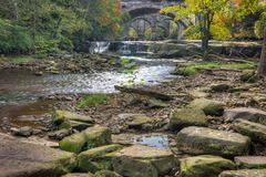 Beautiful Berea Falls In Autumn. Berea Falls Ohio with fall colors. This cascading waterfall looks it`s best with autumn colors in the trees. The stone arch royalty free stock photography