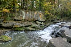 Beautiful Berea Falls In Autumn. A small portion of Berea Falls Ohio during peak fall colors. This cascading waterfall looks it`s best with peak autumn colors in stock images
