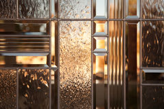 Beautiful Bevelled Glass Window. With Warm Reflections stock image