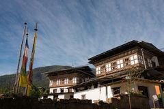 Beautiful Bhutanese House in the countryside of Bhutan. Beautiful Bhutanese House in wooden traditional style in the countryside of Bhutan Royalty Free Stock Image