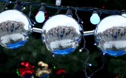 Beautiful, big balls on the Christmas tree in which the whole city is reflected. Beautiful, big balls on the Christmas tree in which the entire city is reflected Stock Photography