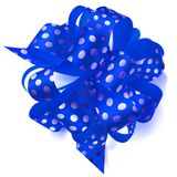Big bow made of ribbon in polka dots. Beautiful big bow made of blue ribbon in polka dots with shadow on white background Royalty Free Stock Images