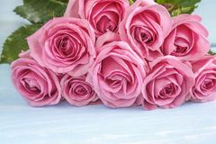 Beautiful big bunch of pink rose flowers lying on the light background stock image