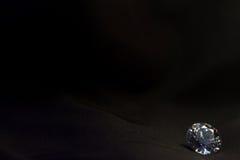 Beautiful big diamond jewelry on black cloth background. Fine natural precious stone Stock Photography