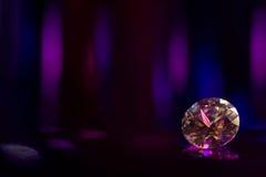 Beautiful big diamond jewelry precious stone on colorful dark background.  royalty free stock images