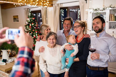Beautiful big family celebrating Christmat together being photog Royalty Free Stock Photos