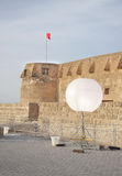Beautiful big glo ball lamp with Arad Fort. Arad Fort is a 15th century fort in Arad, Bahrain Royalty Free Stock Photo