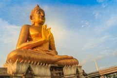 Beautiful big golden Buddha statue on the hilltop at Wat Khao Ba. Ndai It, Phetchaburi, Thailand. Huge golden Buddha statue with blue sky background Royalty Free Stock Photos