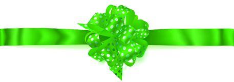 Big horizontal bow made of ribbon in polka dots. Beautiful big horizontal bow made of green ribbon in polka dots with shadow on white background Stock Photo