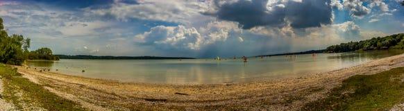 Big lake cloudy horizon with windsurfer and ducks stock photos