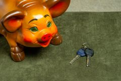 Beautiful big piggy bank and car keys. Clouse-up stock image