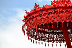 A beautiful big red umbrella in Thai temple Stock Photography