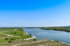 Beautiful big river Olt with green islands in a bright sunny summer day royalty free stock images